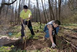 two volunteers working in natural area