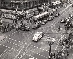 People walking, driving and taking streetcars 1949