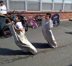 Potato sack race at Safe Routes Spring Kickoff