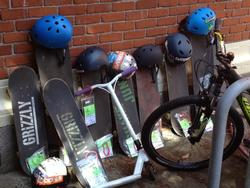 Skateboards and helmets lined up at Beverly Cleary