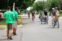 Volunteers cheering people on at Sunday Parkways