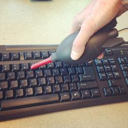 manual dust blower used on keyboard