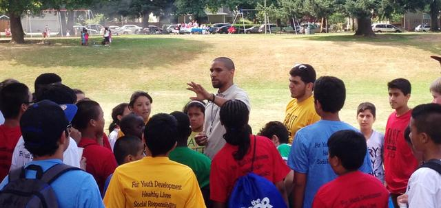 Alando with kids at FAST camp