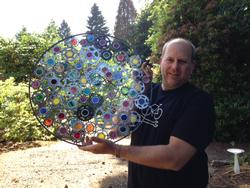 Brian holding one of his upcycled wheels