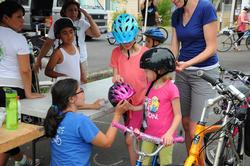 Families being fitted with bike helmets