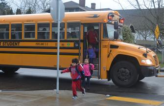 Jumping off the school bus at James John Elementary
