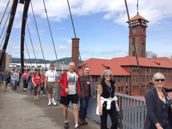 Walking group crossing the Broadway Bridge