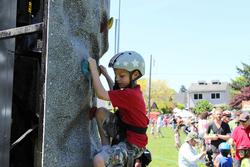 A child on a climbing wall at Sunday Parkways