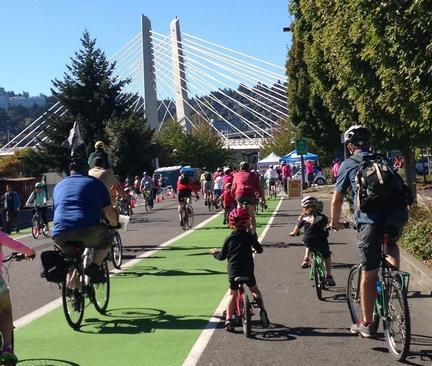 Sunday Parkways children on bikes near bridge