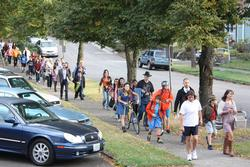 Students and Commissioner Novick walk to school