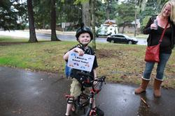 "Boy with a sign, ""I Biked to School today!"""