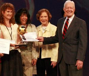 CWSP accepting award from President Carter
