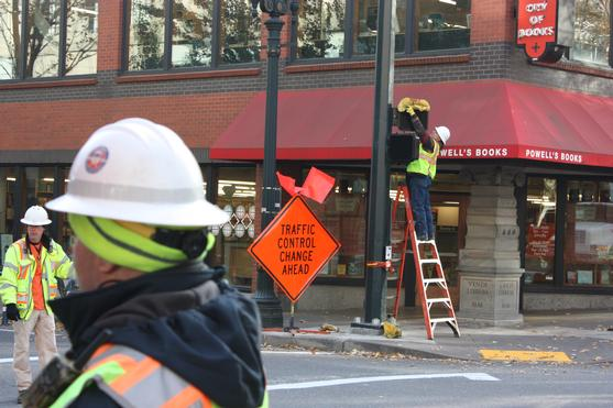 Crew installs pedestrian scramble intersection