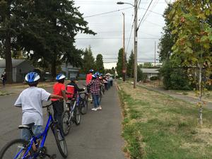 students on community bike ride