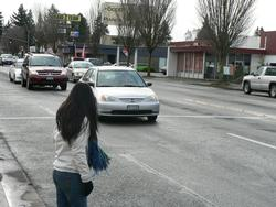 Person waiting at busy intersection