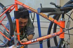 volunteer repairing bike