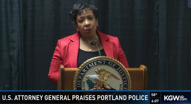 Image of Attorney General Loretta Lynch praising the Portland Police Bureau.