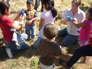 Abigail teaching Cully neighborhood kids safety in soil sampling