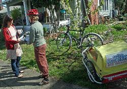A SmartTrips staffer delivers materials by bike.