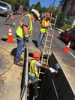 A PBOT sewer crew secures an underground cavity