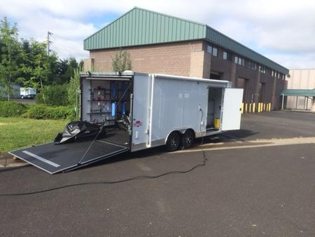 The trailer is a self-contained portable treatment system equipped with a generator, pumps, hoses and other equipment.