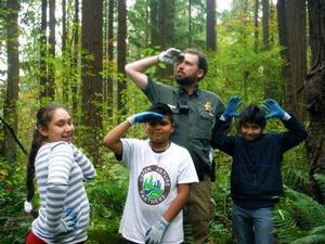 Park Ranger Asa Arden with No Ivy Day youth volunteers in Forest Park.