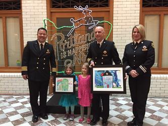 Winners of PF&R's coloring contest pose with PF&R officials
