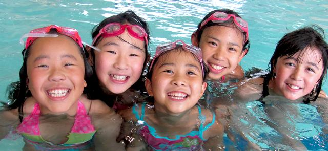 Happy kids swimming at a PP&R indoor pool.