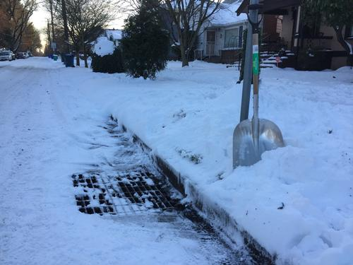 Snow shovel and storm drain