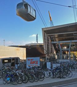 Portland Tram rises over Go By Bike valet parking