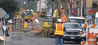 Construction workers working on downtown Portland street