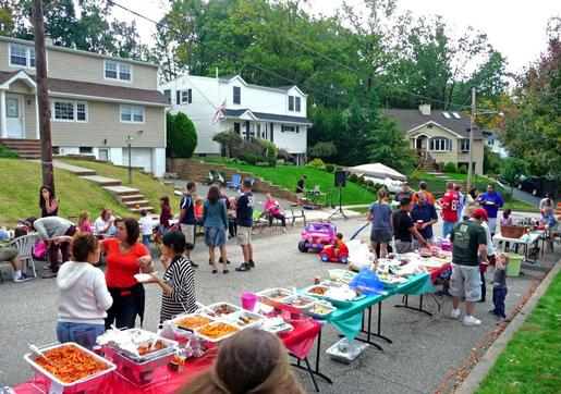 people holding party and potluck in street