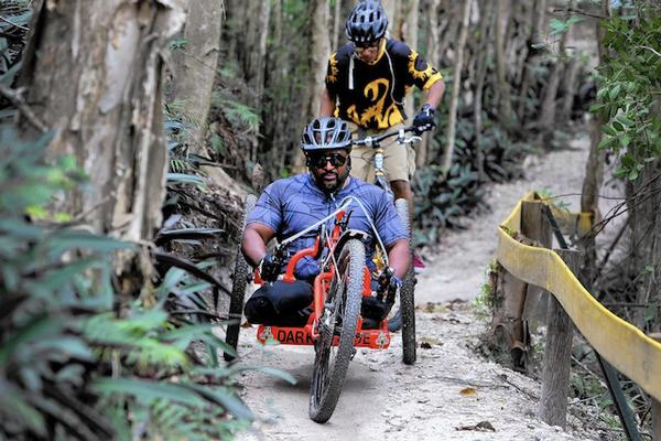Photo of man riding adaptive mountain bike