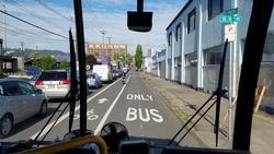Bus driving in clear Pro-time (peak period only) Transit Lane next to lanes congested with vehicles