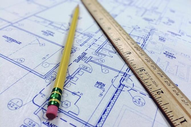 Image of building blueprint with pencil