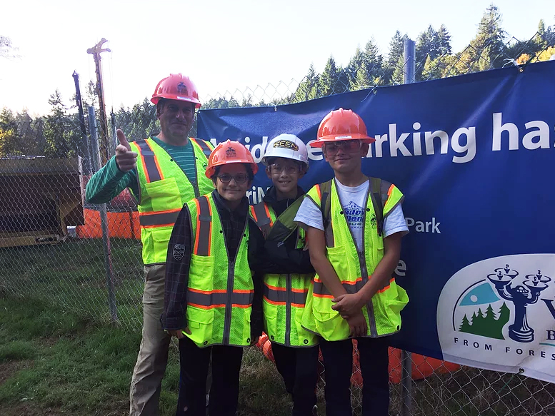 6th graders standing at construction site