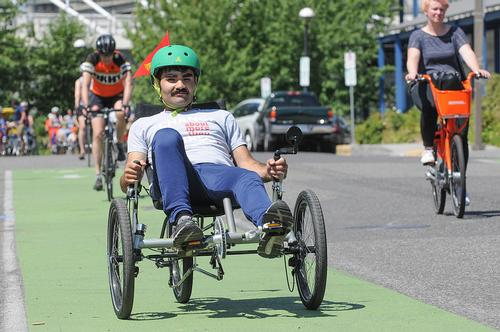 Photo of a man riding an adaptive bike
