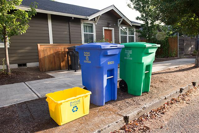 garbage and recycling carts outside residence