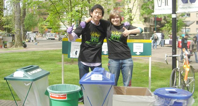 Two young people working recycling at event