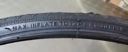 The side of a bike tire, with inflation amount shown.