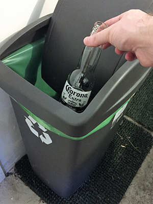 Placing bottle into BottleDrop bag