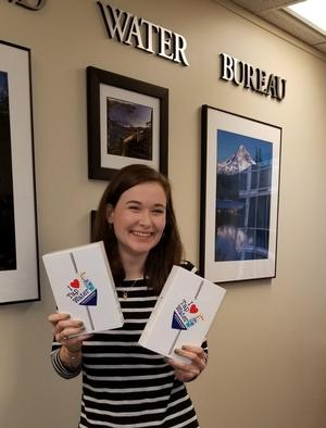Water Bureau employee shows the iPad give-aways