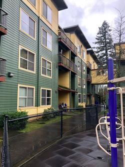 Multi-family housing unit with playground