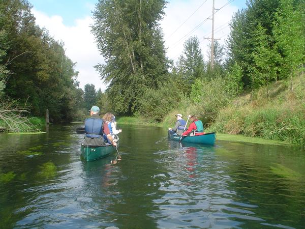 People canoeing in Columbia Slough