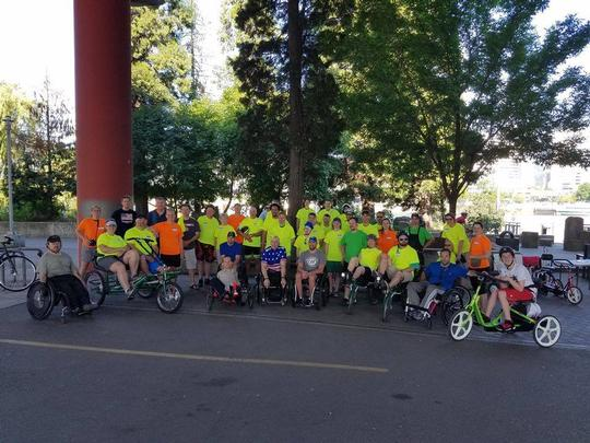 Group photo with some adaptive bikes.
