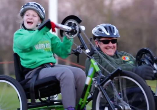 Two handcyclists on the move