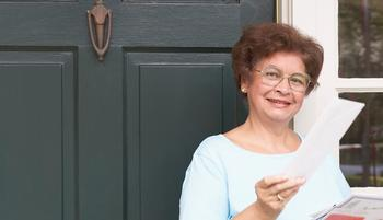 Woman with mail at front door