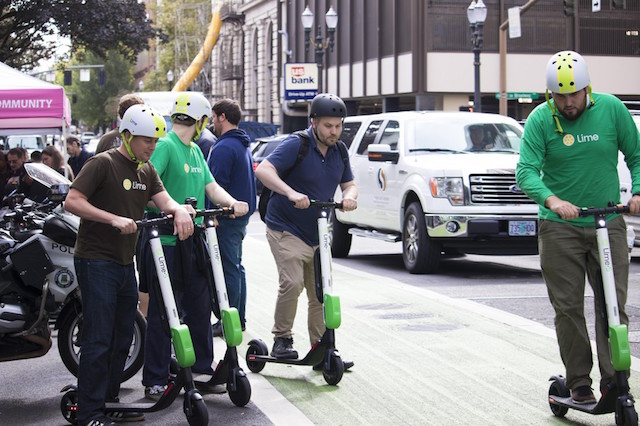 Photo of people at PBOT e-scooter safety event.
