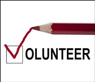 "Image: a red pencil writing ""Volunteer"""