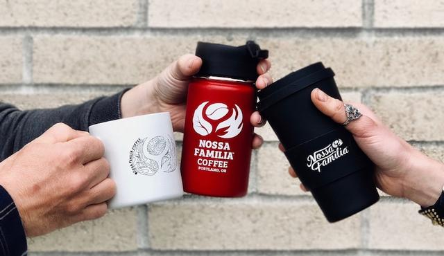 Three people clinking reusable coffee mugs